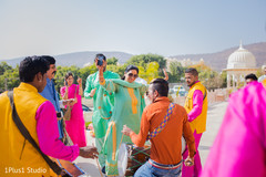 Cheerful guests dancing along the dhol