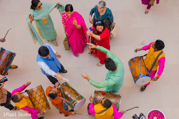 Guests playing the traditional dhol