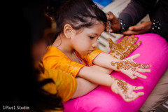 Lovely kid guest showing her mehndi design