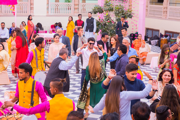 Joyful guests dancing to the dhol sounds