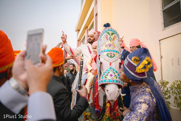 Raja rides the horse as the fun baraat begins