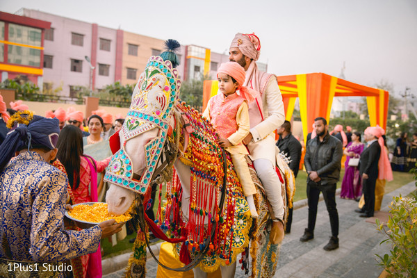 Kid riding with the raja during the baraat