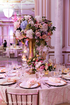 Incredible Indian wedding table floral centerpieces.