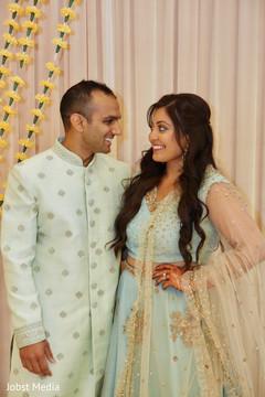 Enchanting indian couple during Mehndi celebration.