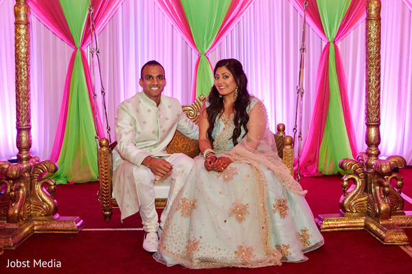 Adorable indian couple posing at the mehndi stage.