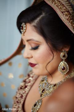 Indian bride getting her Ghoonghaton.