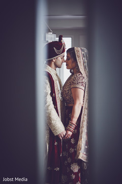 Sweet  Indian bride and groom's first look scene.