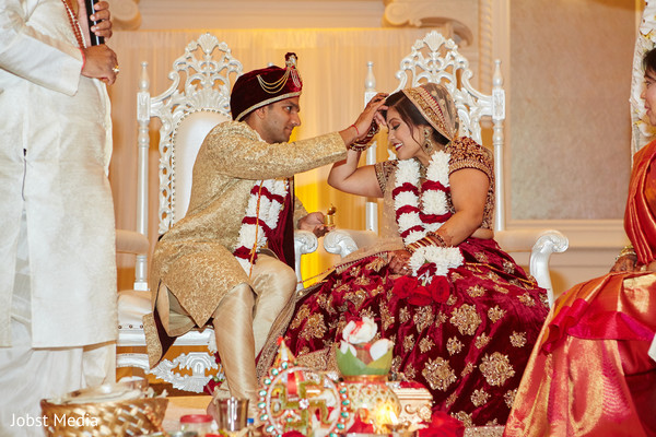 Red mark applied to Indian bride by groom.
