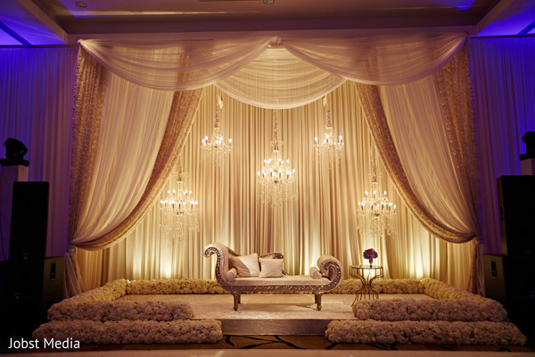 indian wedding reception decor,stage,flowers,draping