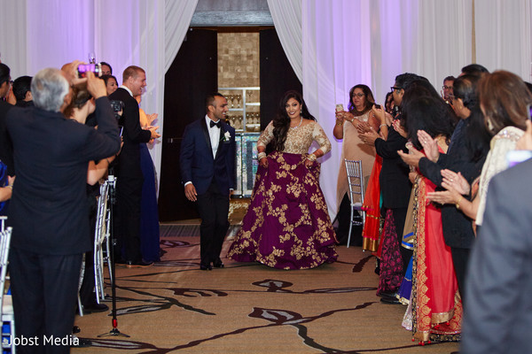 Ravishing Indian bride and groom making their entrance reception.