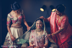 Magnificent capture of Indian bride getting ready.