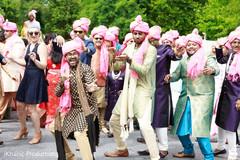 Joyful Indian groomsmen during baraat celebration.
