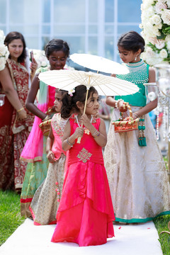 Lovely flower girls walking in to announce the bride is coming.