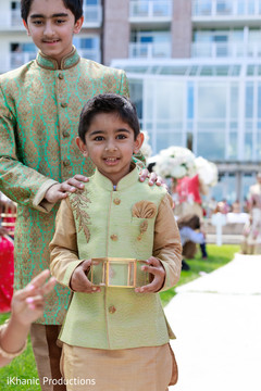 Charming Indian pageboys entrance.