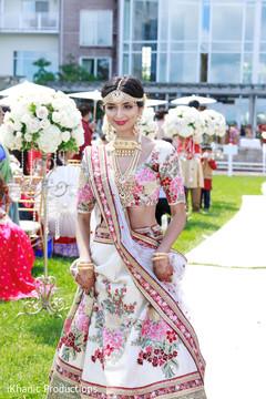 Glamorous Indian bridesmaid at ceremony.