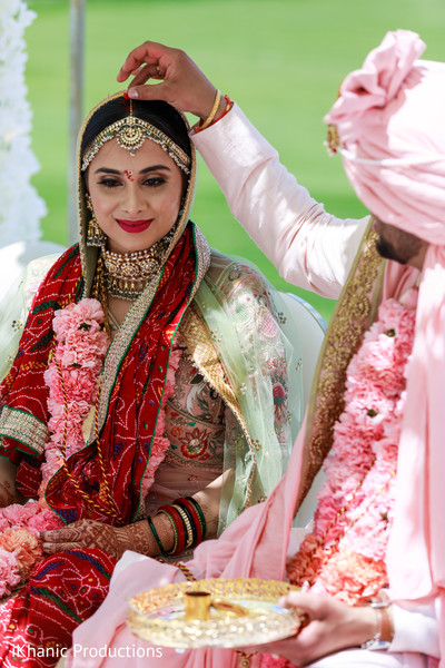 Indian bride when getting the red dot on the forehead.