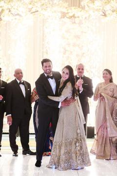 Joyful Indian bride and groom dance performance capture.