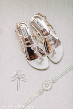Marvelous Indian wedding ceremony bridal shoes, blet and hair pin.