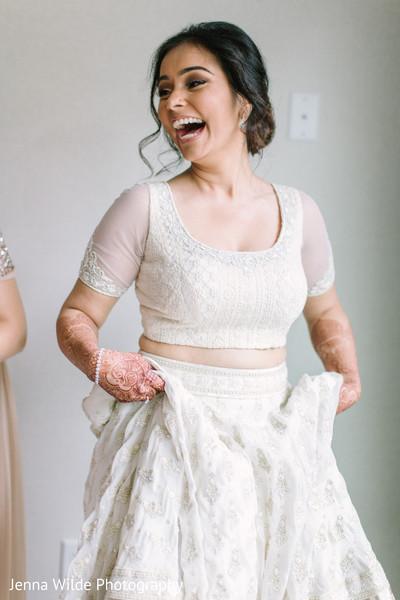 Enchanting Indian bride on her white lehenga.