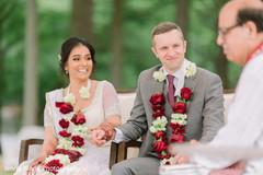 Sweet indian bride looking at groom capture.