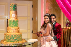 Indian newlyweds about to cut their wedding cake