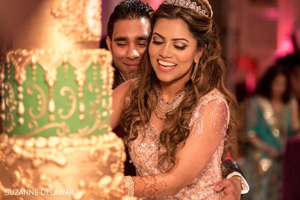 Indian couple cutting their wedding cake