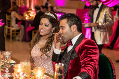 Indian groom sweetly kissing maharani's hand