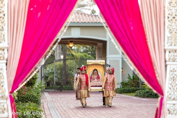 Indian bride being carried on a palanquin