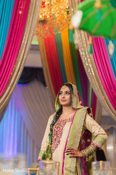 Indian bride modeling her lengha at the venue