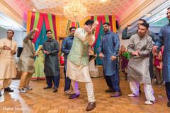 Indian groom having a blast during the pre wedding dance