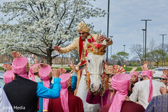 Indian groom riding baraat horse