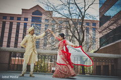 Indian bride showing her wedding lengha