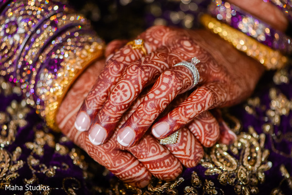 Mehndi design details on maharani's hand
