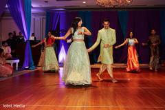 Indian couple dancing during sangeet