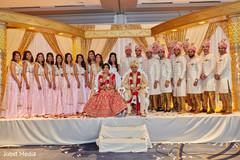 Indian newlyweds with their bridal party