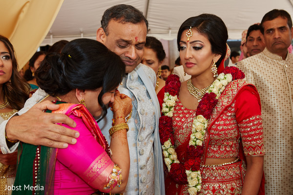 Indian bride saying goodbye to her parents