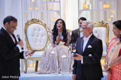 Indian bride enjoying wedding speeches