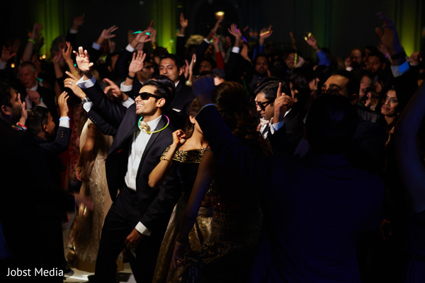 Indian wedding guests showing some dance moves