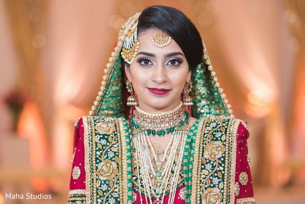 Stunning maharani posing for pictures with bridal outfit