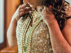 Mehndi design details on the beautiful maharani