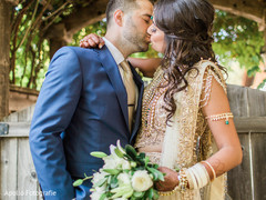 Indian bride and groom kissing during the photo shoot
