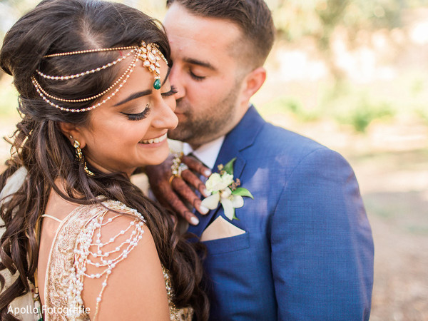 Indian groom kissing the beautiful Indian bride
