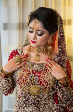 Indian bride showing her lovely jewelry set