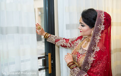 Indian bride looking out the window