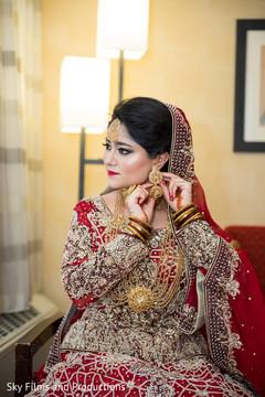 Maharani putting on her earrings