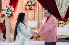 Indian bride parent's dancing