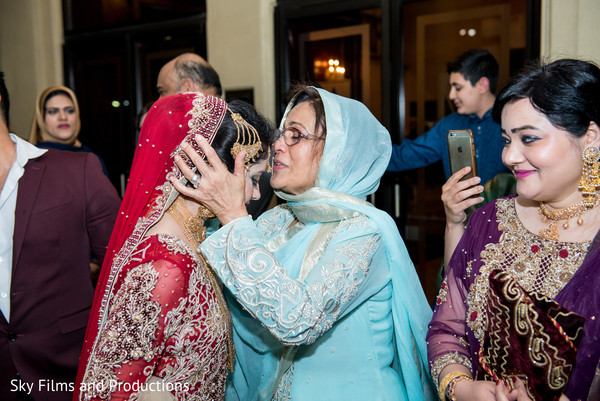 Indian bride saying goodbye to her family