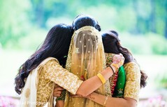 Lovely moment between the Indian bride and her bridesmaids