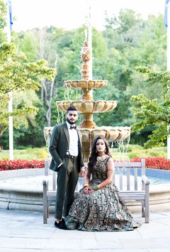 Amazing shot of Indian newlyweds by the fountain