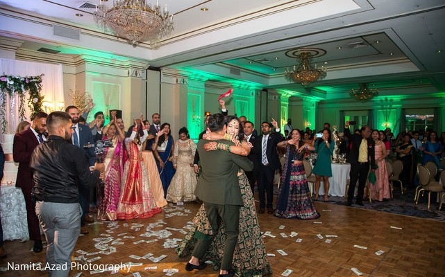 Guests and Indian couple having a great time during the dance